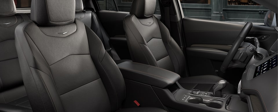 JET BLACK LEATHERETTE WITH CINNAMON ACCENTS SEATS